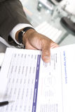 Homme d'affaires With Investment Papers Photographie stock libre de droits