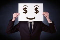 Homme d'affaires jugeant de papier avec émotion avide Image libre de droits