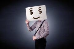 Homme d'affaires jugeant de papier avec émotion avide Photographie stock libre de droits