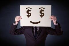 Homme d'affaires jugeant de papier avec émotion avide Photo stock