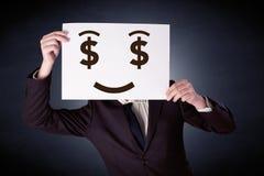 Homme d'affaires jugeant de papier avec émotion avide Photo libre de droits