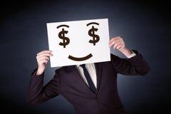 Homme d'affaires jugeant de papier avec émotion avide Photographie stock