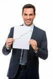 Homme d'affaires jugeant de papier avec le diagramme croissant Photographie stock