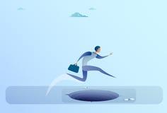 Homme d'affaires Jump Over Gap au concept de risque d'homme d'affaires de succès Images stock