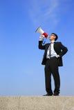 Homme d'affaires à l'aide du mégaphone Image libre de droits
