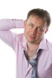 Homme d'affaires Lien de port de sourire d'homme sexy sur le fond blanc photographie stock
