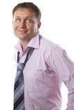 Homme d'affaires Lien de port de sourire d'homme sexy sur le fond blanc photos libres de droits