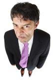 Homme d'affaires méchant avec une attitude Photographie stock libre de droits