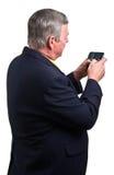 Homme d'affaires mûr envoyant le message avec texte Photos stock