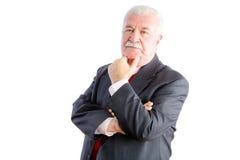 Homme d'affaires mûr réfléchi dans le costume Photos stock