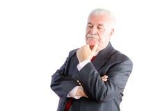 Homme d'affaires mûr sérieux pensant sur le blanc Images stock