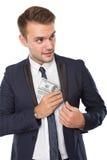 Homme d'affaires mettant l'argent dans la poche Images libres de droits