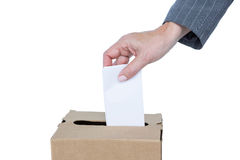 Homme d'affaires mettant le vote dans la boîte de vote Photographie stock libre de droits