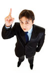 Homme d'affaires moderne étonné avec le doigt rised Image libre de droits