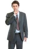 Homme d'affaires moderne affichant le geste de shh Image stock