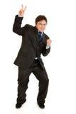 Homme d'affaires moderne heureux affichant le geste de victoire Photo libre de droits