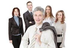 Homme d'affaires moderne sur le fond de l'équipe d'affaires Photographie stock libre de droits