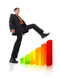 Homme d'affaires montant un diagramme Photo libre de droits