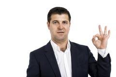 Homme d'affaires montrant le geste CORRECT Image stock
