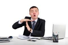 Homme d'affaires montrant le geste de temps mort Image stock