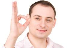 Homme d'affaires montrant le signe correct Images stock