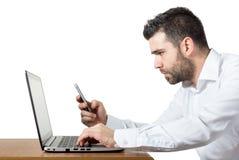 Homme d'affaires multitâche Photographie stock libre de droits