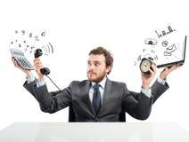 Homme d'affaires multitâche Photos stock