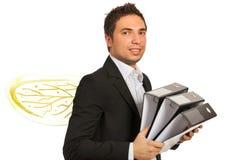 Homme d'affaires occupé comme abeille avec des dépliants Images libres de droits