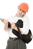 Homme d'affaires occupé dans son casque Photo stock