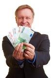 Homme d'affaires offrant le crédit instantané Photos libres de droits