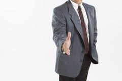 Homme d'affaires offrant pour la prise de contact Image stock