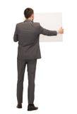 Homme d'affaires ou professeur avec le conseil blanc du dos Photographie stock