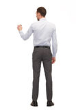 Homme d'affaires ou professeur avec le marqueur du dos Photos libres de droits