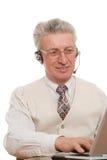 Homme d'affaires par son ordinateur portatif Image libre de droits