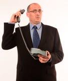 Homme d'affaires parlant au propriétaire fâché Photographie stock libre de droits