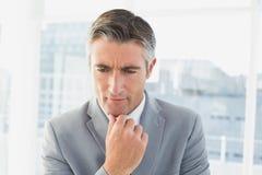 Homme d'affaires pensant à son travail Photo libre de droits