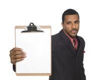 Homme d'affaires - planchette blanc image stock
