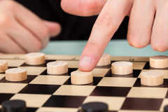 Homme d'affaires Playing Checkers Photographie stock