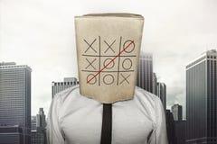 Homme d'affaires portant le sac de papier brun sur la tête Images libres de droits