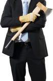 Homme d'affaires portant une hache pour faire le hachage Photographie stock libre de droits