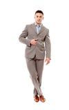 Homme d'affaires positif avec des jambes croisées Image stock