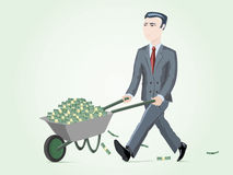 Homme d'affaires poussant le chariot complètement de l'argent Photographie stock libre de droits