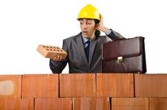 Homme d'affaires près de mur de briques Images libres de droits