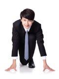 Homme d'affaires prêt à commencer à exécuter image stock