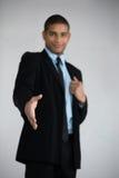 Homme d'affaires prêt à serrer la main Images stock