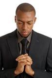 Homme d'affaires priant avec des yeux fermés Images libres de droits