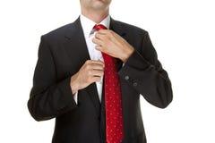Homme d'affaires réglant la relation étroite Photos stock