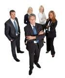 Homme d'affaires réussi aboutissant son équipe sur le blanc Photo libre de droits