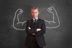 Homme d'affaires réussi avec des muscles de craie photos stock