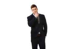 Homme d'affaires réussi avec le doigt sous le menton Photographie stock